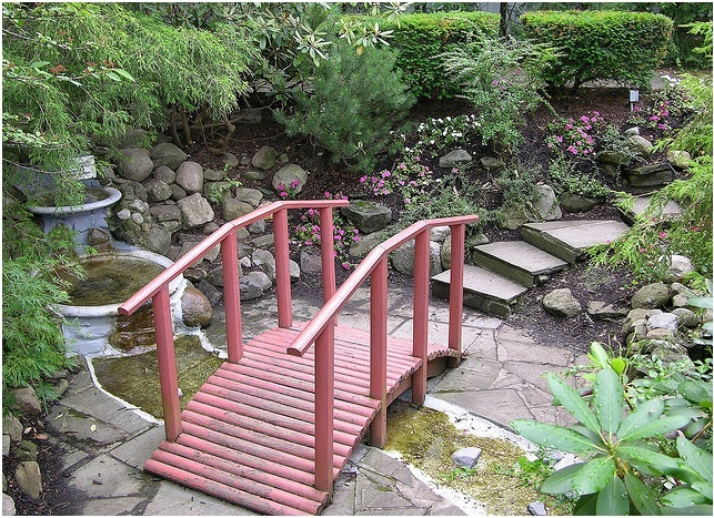25 stunning garden bridge design ideas for Decorative fish pond bridge