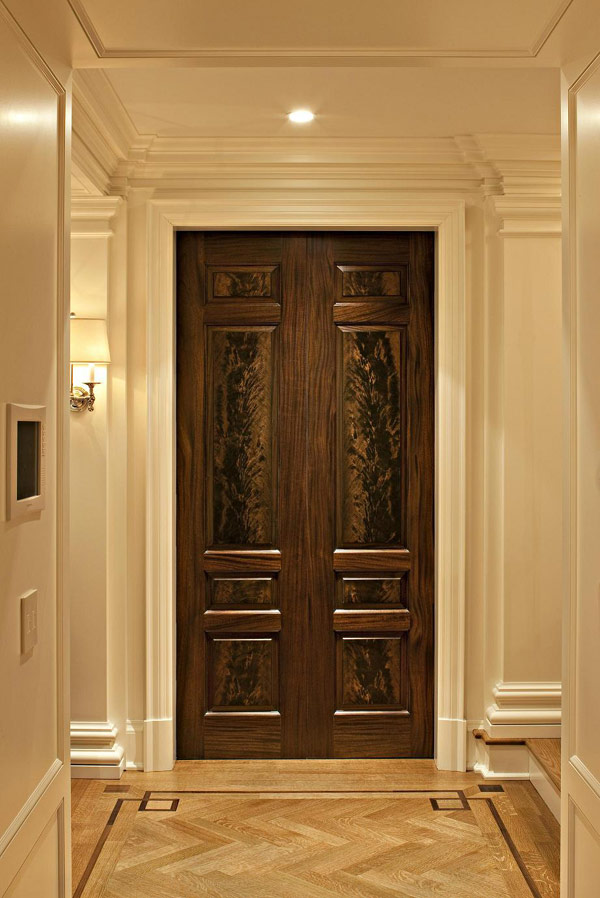 Fancy-Traditional-Entry-Design-Showing-Hardwood-Door-and-Chevron-Floor