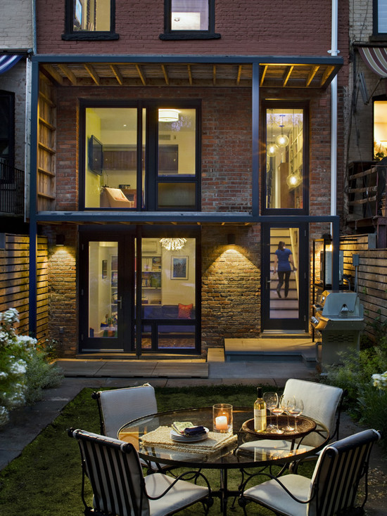 eclectic-patio-with-outdoor-lounge-wirh-round-table-glass-with-arm-chair