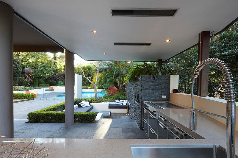 large-backyard-modern-house-design-with-outdoor-living-with-sunken-lounge-kitchen-food-preparation-area-with-views-of-the-garden-and-cabinet-with-light-brown-marble-countertop-ideas