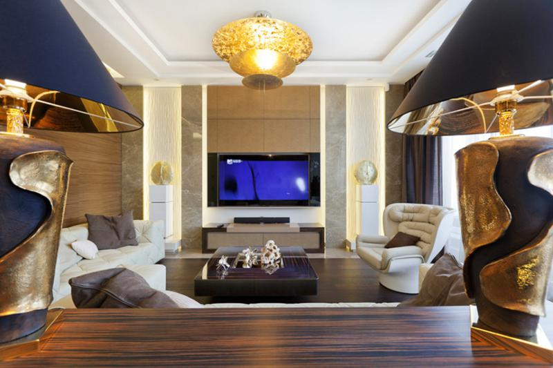 living-rooms-for-small-spaces-with-golden-lamp-in-the-roof-and-big-flat-tv-in-the-brown-wall-and-three-cream-sofa-one-bedroom-apartment-decorating-ideas-on-a-budget