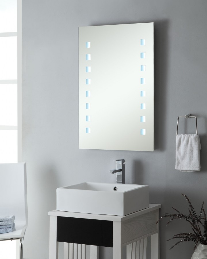 modern bathroom mirror with lighting over a bathroom sink bowl with