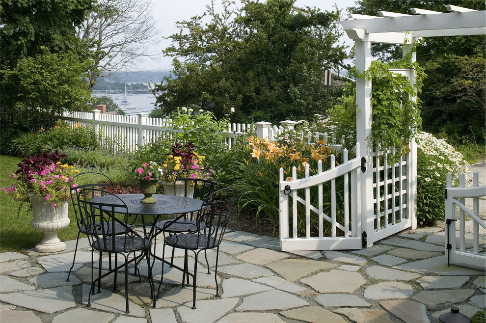 Glamorous-Dog-Fences-convention-Boston-Beach-Style-Patio-Decorators-with-arbor-black-metal-dining-set-bluestone-terrace-fence-and-gate-flagstone-flowering-plants-metal