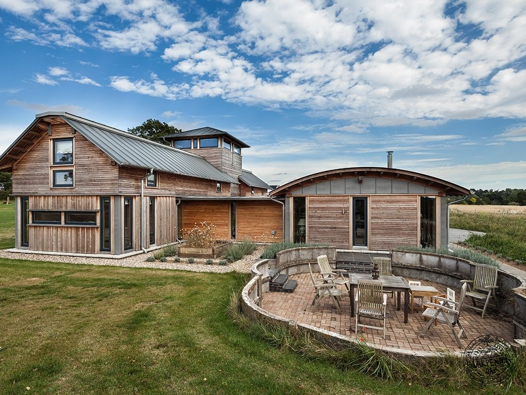 exterior-of-farmhouse-with-patio-decking-casestudy-douglasfir-framed-newbuild-farmhouse-east-anglia-SM