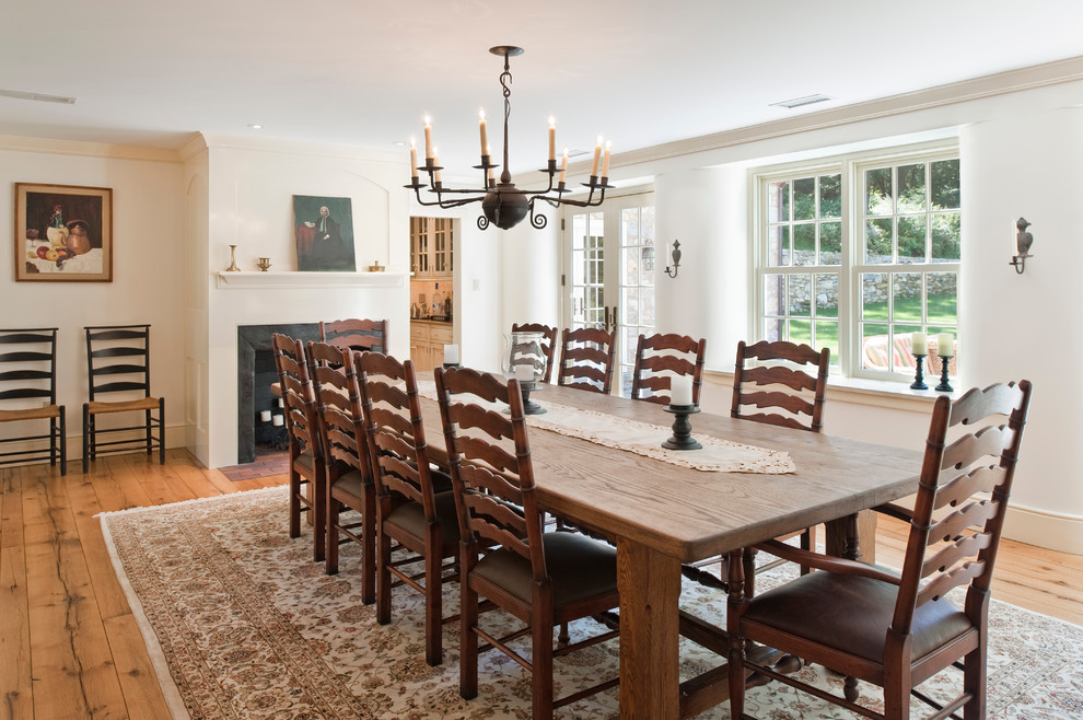 round-farmhouse-dining-table-Dining-Room-Farmhouse-with-antique-chandelier-area-rug