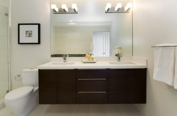 White-countertop-and-dark-cabinetry-make-this-bathroom-vanity-stylish-and-beautiful