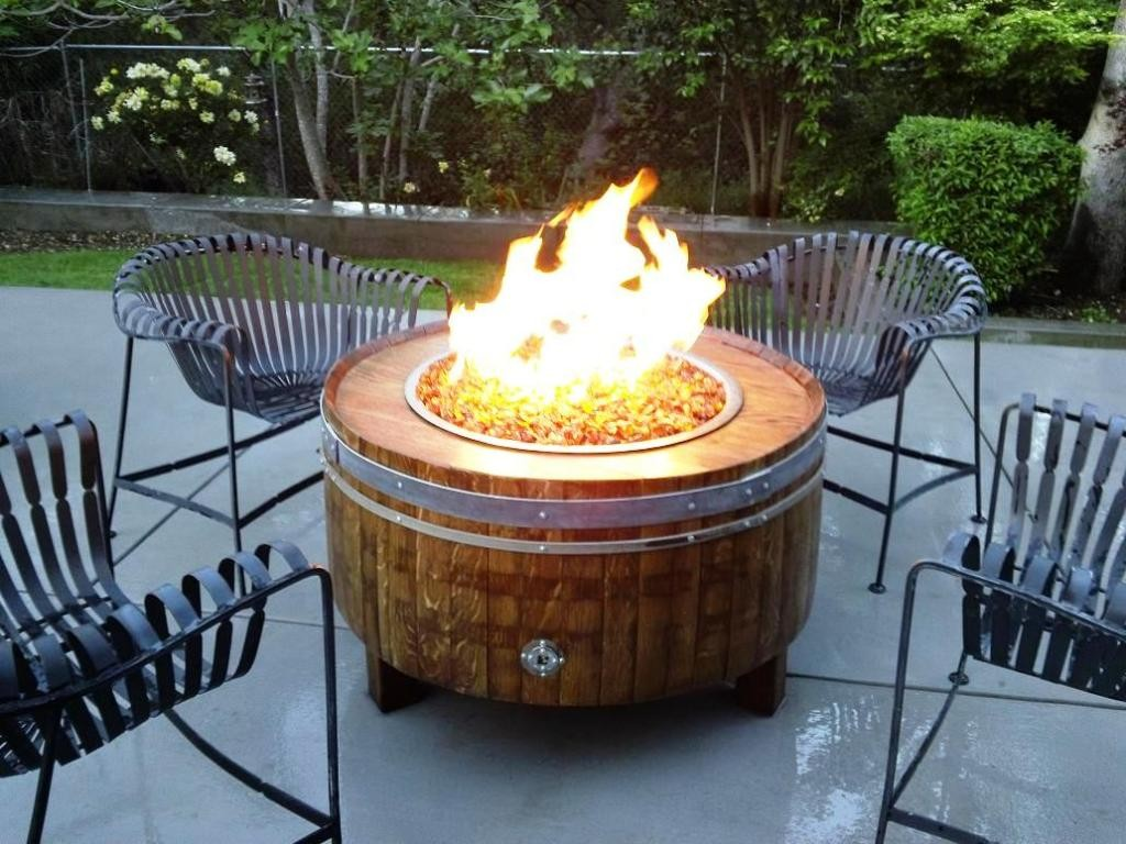 romantic-patio-design-decorated-with-outdoor-chairs-and-wine-barrel-table-complete-with-firebowl