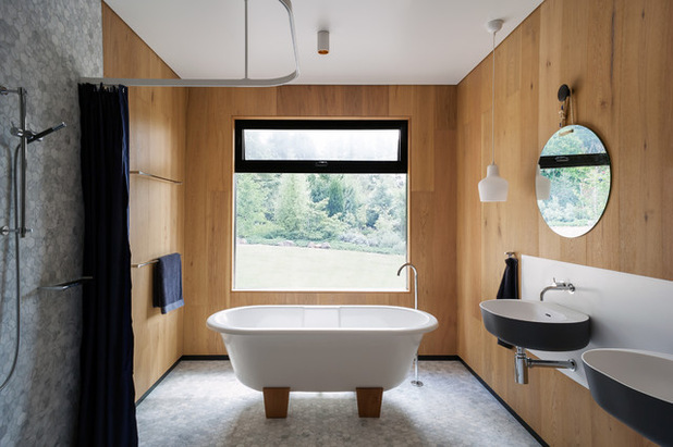 Contemporary bathroom with wooden wall covering.