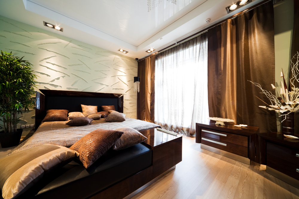 Dark and textured is what this bedroom