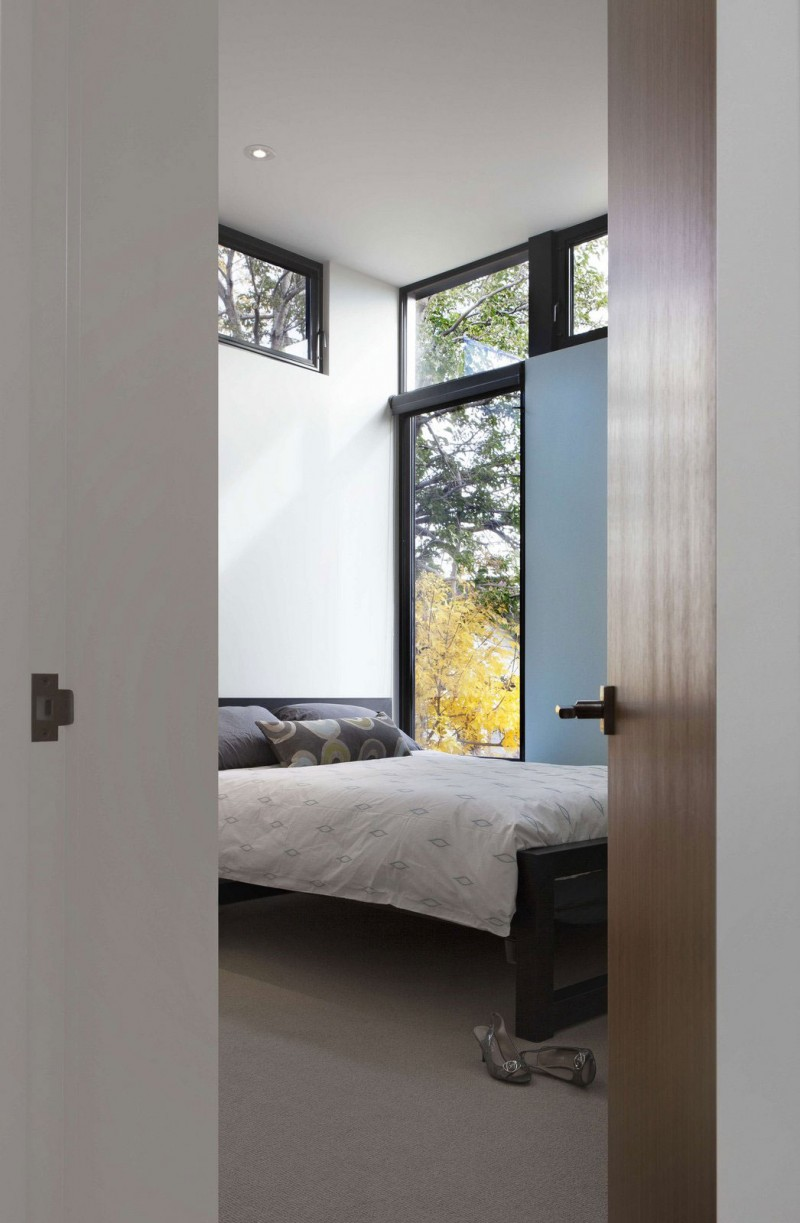 astonishing-bedroom-ideas-with-floor-to-ceiling-window-wooden-bed-frame-and-wooden-door-panel