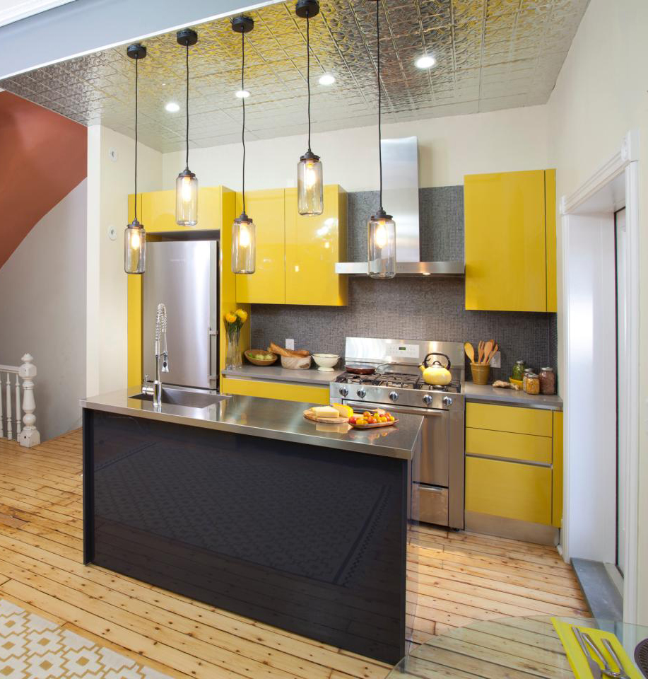 Bright Yellows And Metallic Surface Kitchen