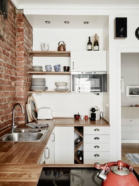 Kitchen With Exposed Brick Walls