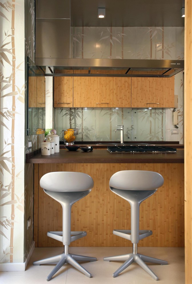Mid-sized Tropical U-shaped Kitchen