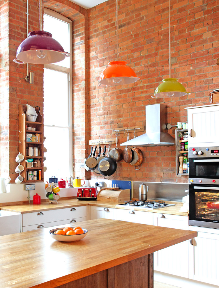Eclectic Kitchen With Exposed Brick Wall