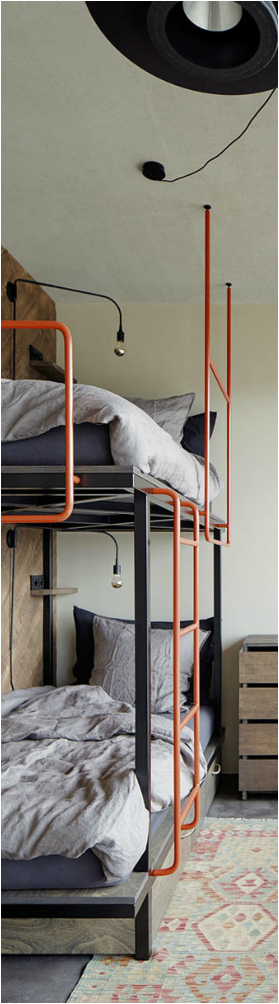Industrial Style Bunk Bed Finished Off With Orange Metal Components Thewowdecor