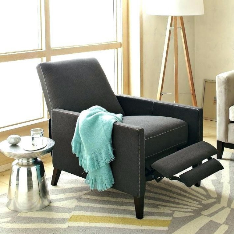 Modern grey recliner complemented with a silver side table and white floor lamp