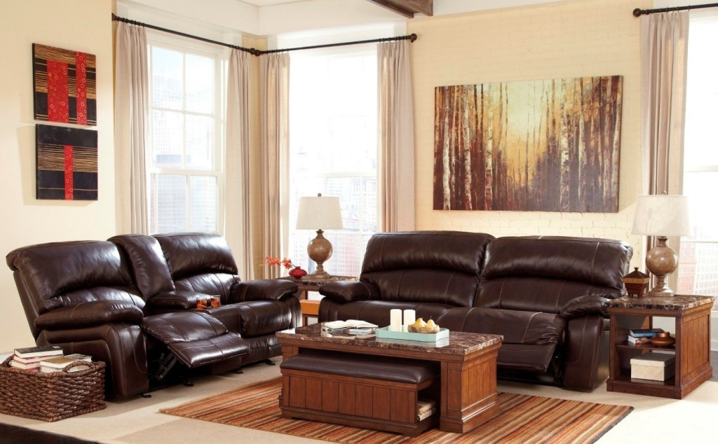 Stunning leather reclining sofa with a cream wall set up and matching furniture