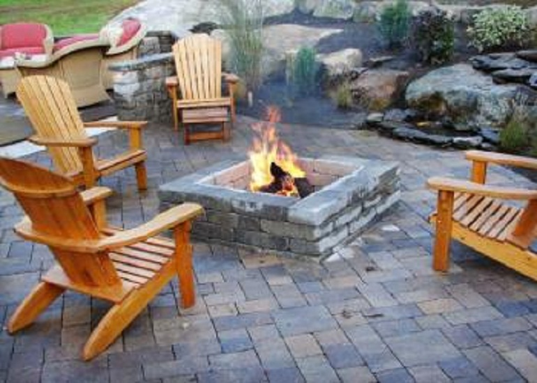 Make arrangement for fireplace design with stones