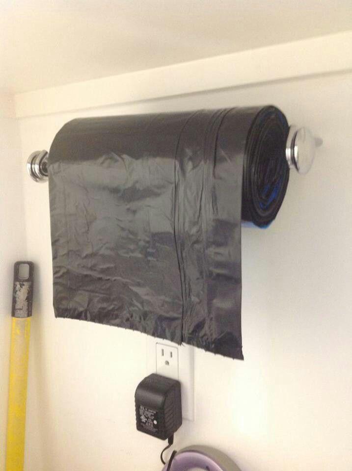 Use a Towel Holder as a Trash Bag Dispenser