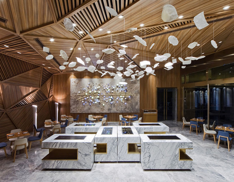 The sculpted wooden ceiling