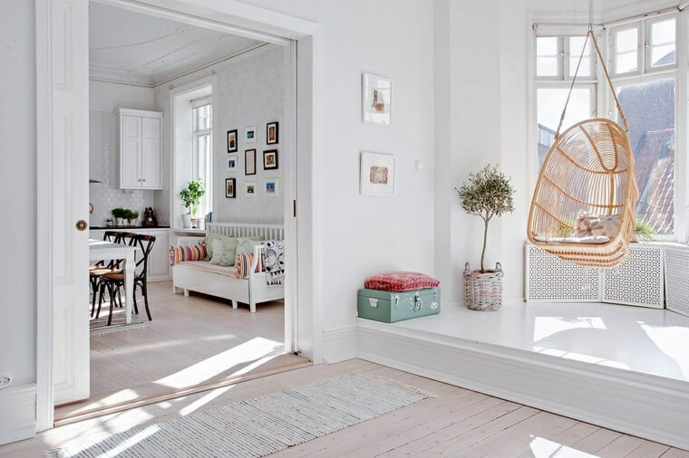 White interior with a brown hanging hammock